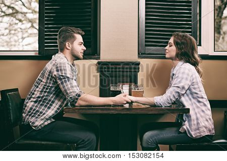 Happy young couple on date in pub