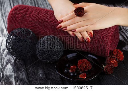 Red Manicure With Rose Flowers. Spa