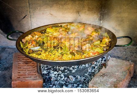 Making Traditional Spanish Paella Over Open Fire With Wood  Coal