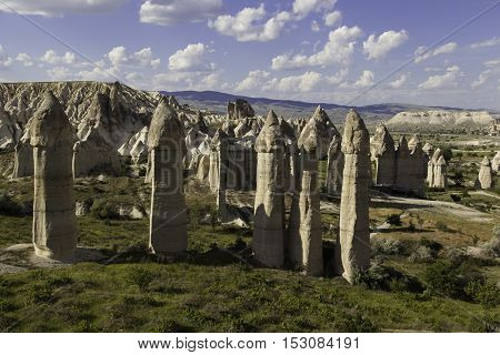 Five prehistoric rock formations in front of Love valley in Turkey shot during cloudy day