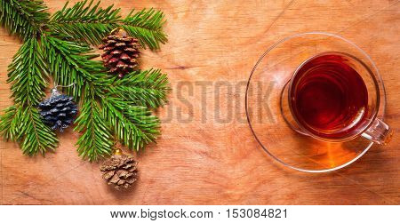 Glass Cup Of Tea On An Old Rustic Table With Pine Branch.new Year.