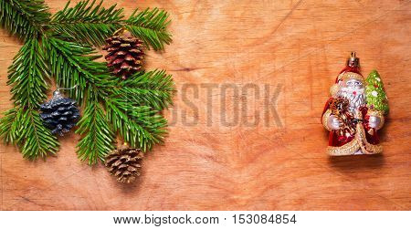 Christmas Tree Twig And Green Santa Claus On Wooden Old Rustic Background. New Year