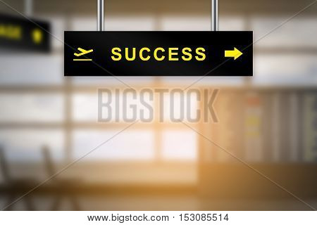 success on airport sign board with blurred background and copy space