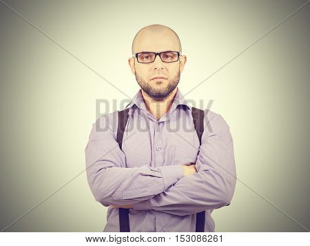Serious Bald Man With Arms Crossed