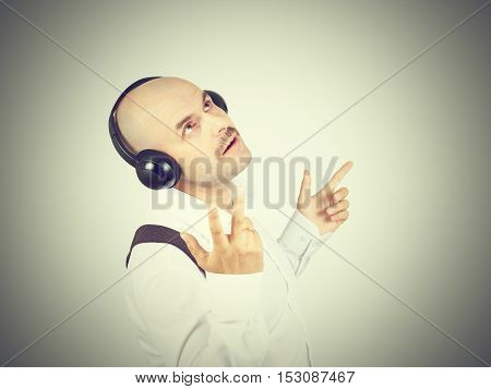Mustache Businessman Listening To Music On Headphones And Sings