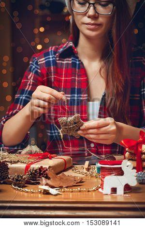 Woman creates a woolen star. DIY. Hand made