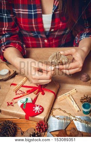 Woman creates a woolen heart. DIY. Hand made
