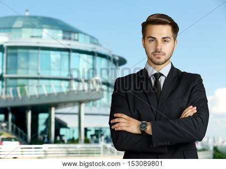 Businessman on blurred building background