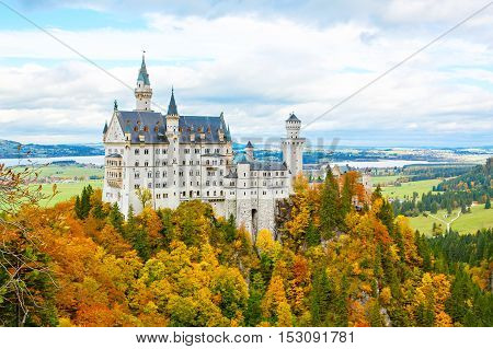 Neuschwanstein Castle, Germany. Image of the famous tourist attraction surrounded with autumn colors during fall.