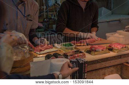 TOKYO  , JAPAN - OCTOBER 12 ,2016 : Tsukiji Market  , Tokyo, Japan. October 12 2016 Chefs are cooking Sushi at Tsukiji market.