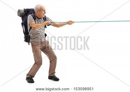 Full length profile shot of a mature hiker pulling a rope isolated on white background