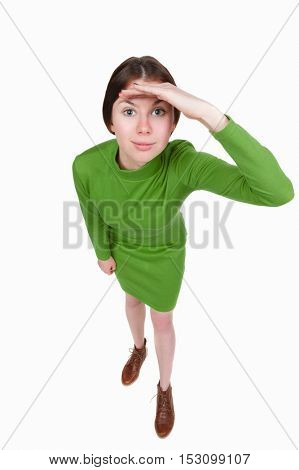 Funny portrait of a woman gazing into the frame. Wide-angle. Isolated over white background. A girl in a short green dress looks in the frame.