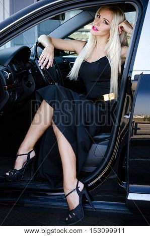 Elegant Woman In The Car