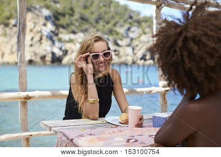 Young couple stand embracing by the sea, close up, Ibiza