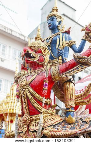 Suratthani Thailand - October 20 2016: Details on ornamented carriers of Buddha images depicting Narai Song Suban (Vishnu mounting the Garuda) to be pulled across the city during the famous Chak Phra Festival an annual Buddhist festival to celebrate the r