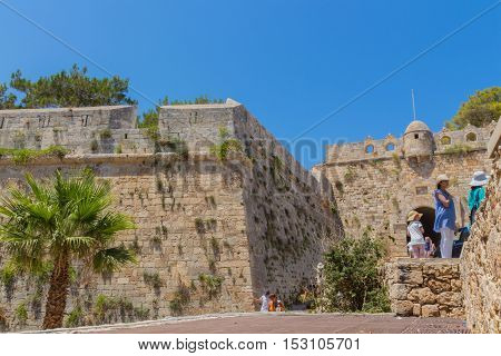 Rethymno Greece. July 26. 2016: Tourists in front of Fortezza Castle. The Fortezza is the citadel of the city of Rethymno in Crete Greece. It was built by the Venetians in the 16th century and was captured by the Ottomans in 1646.