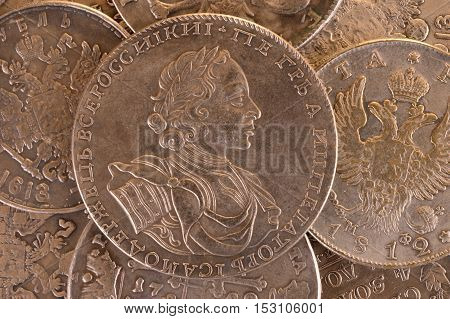 Vintage background silver ruble coin 1722 Russian emperor Peter A. Autocrat of all Russia