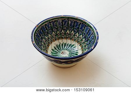 One Typical Central Asian Bowl On White Plaster