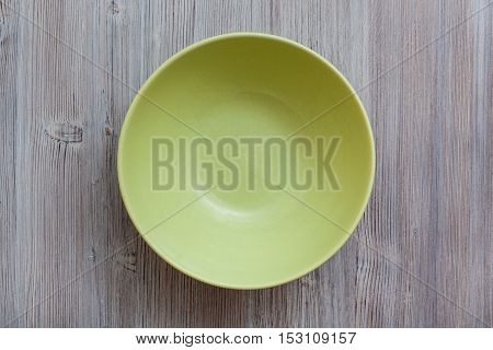 Above View Of Green Bowl On Gray Brown Table