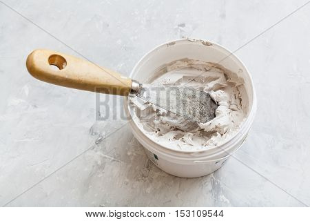 Metal Spatula In Pot With Putty