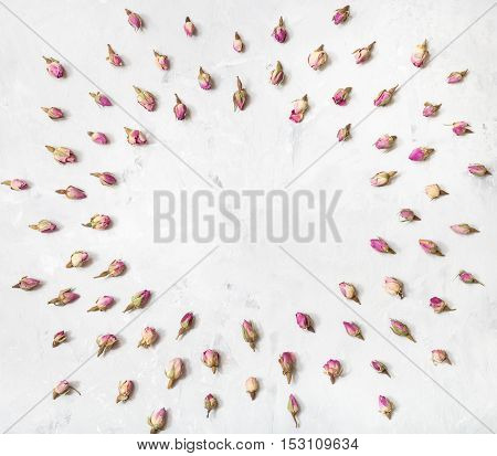 Frame From Rose Flower Buds On Gray Concrete Plank