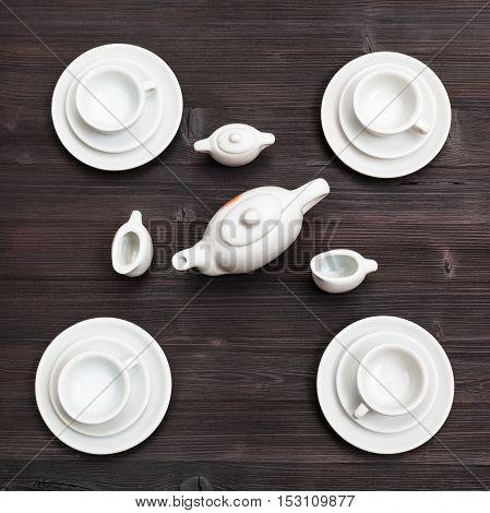 Above View Of Tea Set On Dark Brown Board