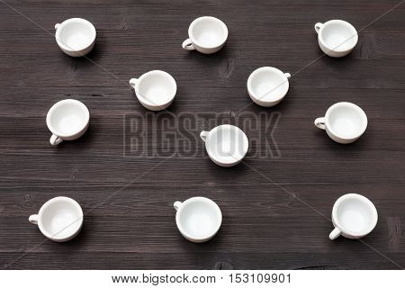 Above View Of Many White Cups On Dark Brown Table