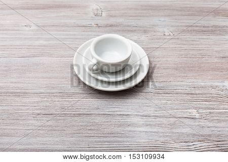 One White Cup With Saucers On Gray Brown Board