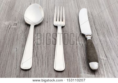 Flatware Set From Knife, Fork, Spoon On Wood Board