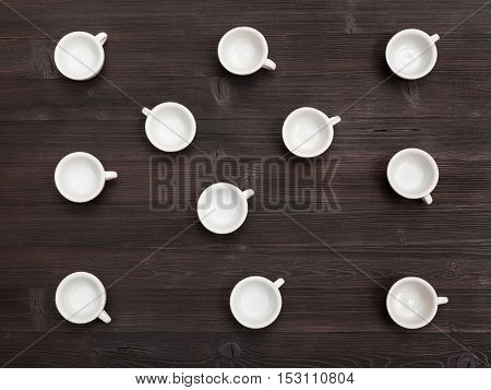 Top View Lot Of White Cups On Dark Brown Board