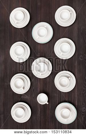 Top View Of Cups And Saucers On Dark Brown Table