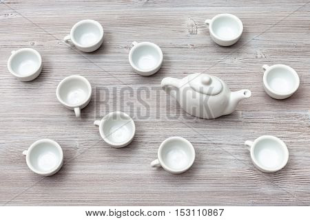 Top View Of Many White Ceramic Cups And Teapot