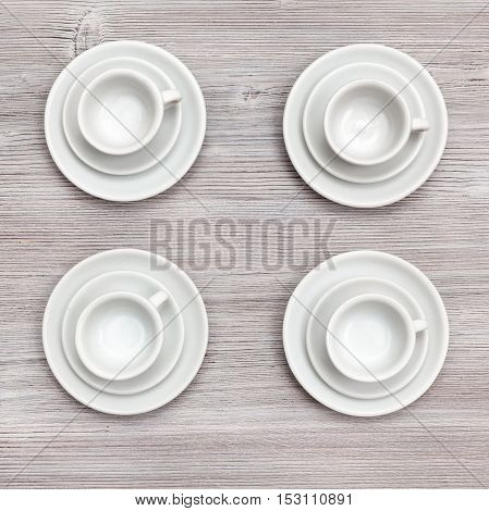 Top View Of Four Cups And Saucers On Gray Board