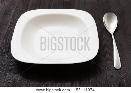 White Bowl With Steel On Dark Brown Board