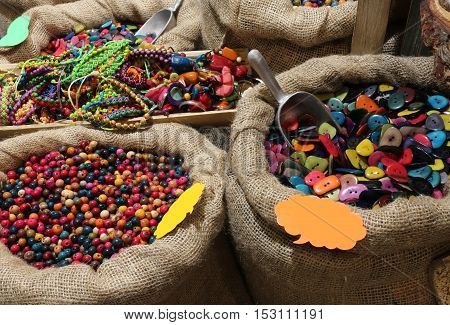 Jute Bags Filled With Trinkets And Decorations Buttons