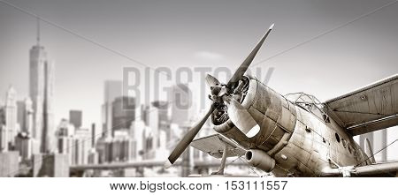 biplane against the skyline of new york