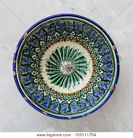 Typical Central Asian Bowl On Gray Concrete Plate