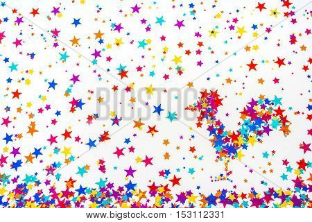 Multicolored asterisks scattered on a white background and the figure of a stacked of asterisks. Suitable for new year or Christmas background 2017.
