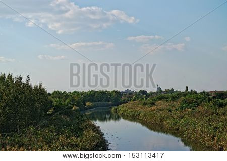 Landscape of a polluted canal in the countryside