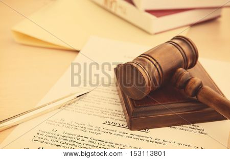 Court gavel and documents on table