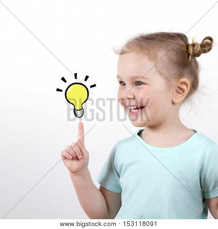 Smart child girl with light bulb isolated on white background. idea concept. school concept.
