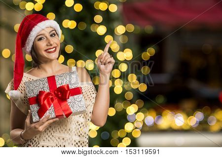Woman Happy Smile Point Finger Showing Side Empty Copy Space, Young Excited Girl Wear Santa Hat, Adv