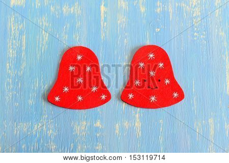 How to make a Christmas bell decor. Step. On one side embroidered with black thread eyes and mouth. On two sides embroidered with white thread snowflakes. Christmas felt sewing set. Top view