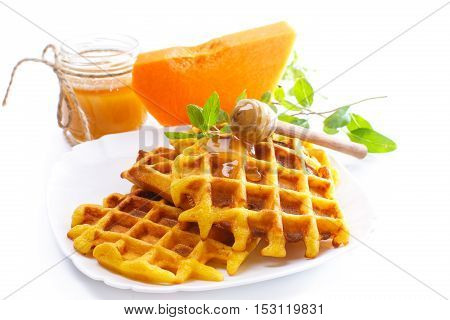 pumpkin waffles with honey on white background