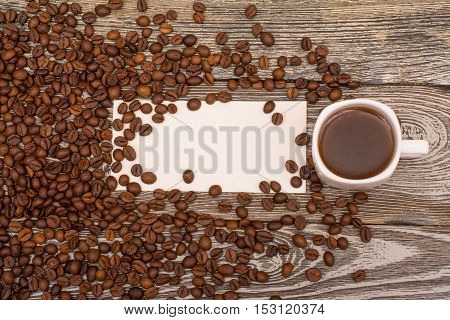 Coffee beans cup of coffee blank for text on wooden table