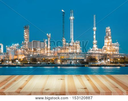 Oil refinery and wood floor at twilight.