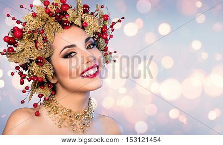 Christmas Woman - Fashion Model With Golden leaf  And Red holly Hairstyle And Makeup