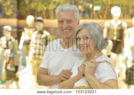 Portrait of beautiful elderly couple in shopping mall