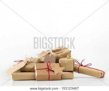 Rustic retro gifts, present boxes on white background. Christmas time, vintage mood. Handmade eco paper wrap.