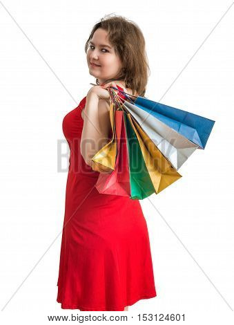 Young Pretty Woman Is Shopping With Colorful Bags. Isolated On W